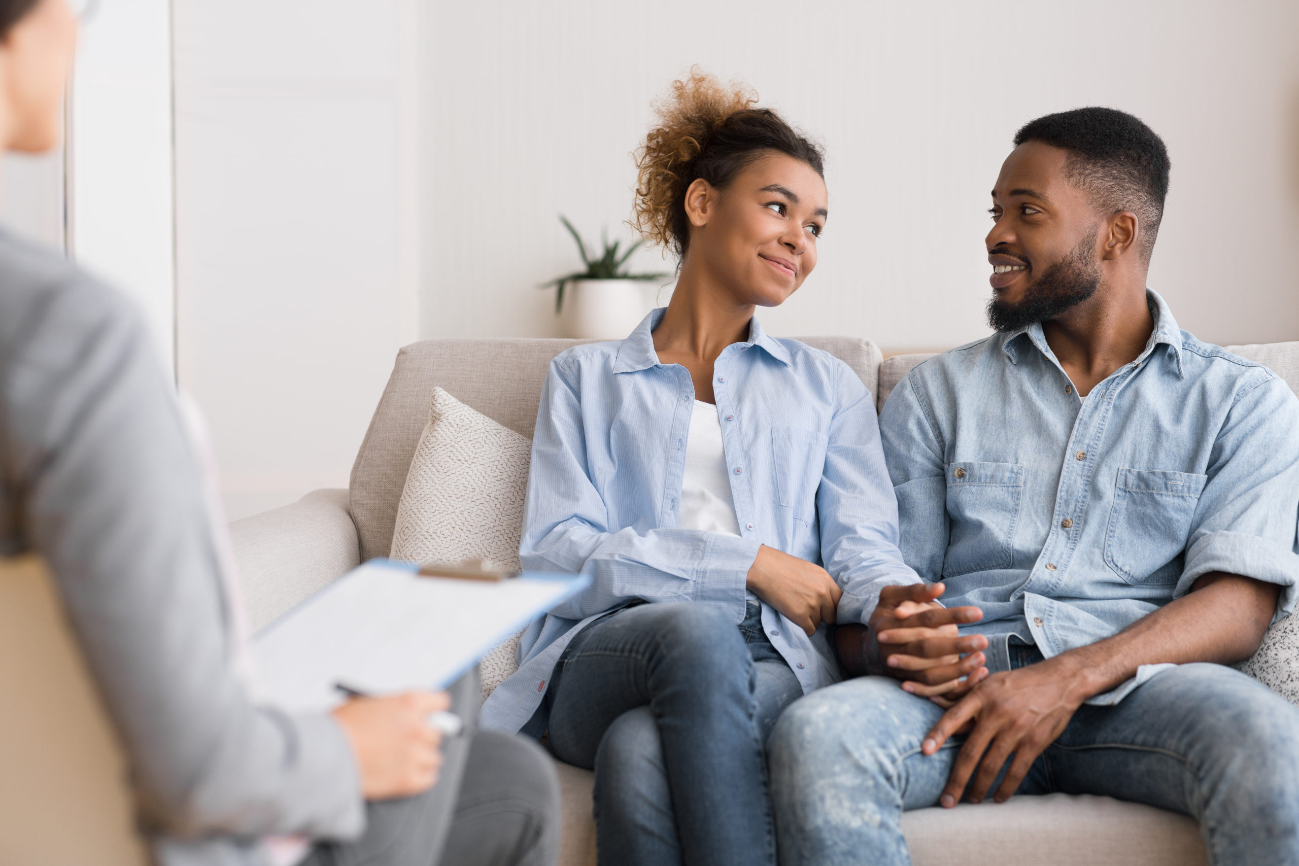Loving Black Couple Visiting Therapy Session At Psychologist's Office